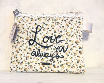 Fabric cosmetic bag with personalized phrase