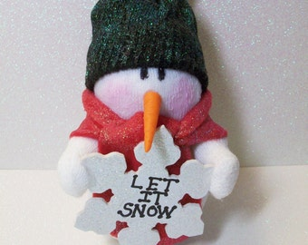 Let it snow snowman with a shovel: stuffed snowman table top decoration
