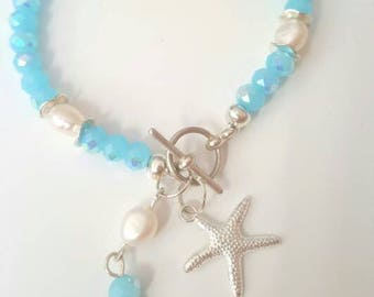 BEACH ADVENTURES - blue beaded bracelet with freshwater pearls and starfish charms