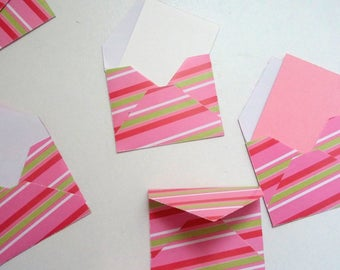 Set of small striped pink envelopes