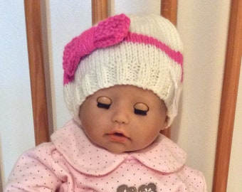 baby hat cream with pink trim hand knitted