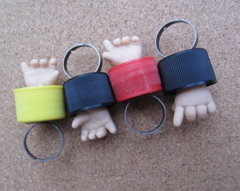 upcycled  doll hand bottle cap ring -red Baby fight club lefty