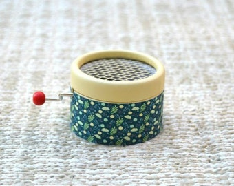 Spring Small Music Box. Hand cranked music box. Green leaves.