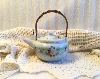 Tiny Ceramic Teapot with Wicker Handle