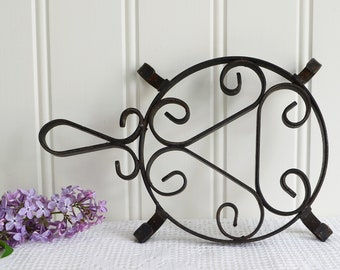 Rustic black cast iron trivet, vintage table protection , rusty kitchen utensil