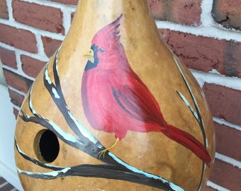 Hand painted gourd birdhouse with winter cardinal
