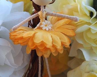Flower fairy doll. Little yellow ballerina.