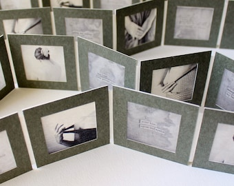 artists' book with black and white photos and collaged poetry