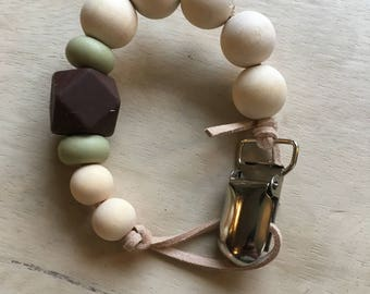 Wooden bead, silicone, and leather pacifier clip neutral gender