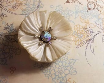Petite and delicate antique floral pin with rhinestone center