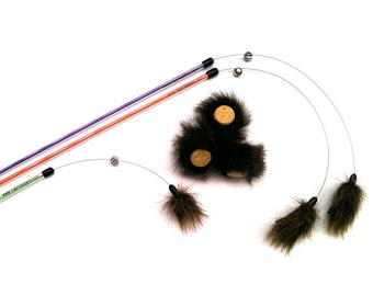Multi-Cat Toy Pack. A cat toy combo pack including 2 Lion Lure teaser play wands, 1 Lion Lure Mini & 3 Bunnies. Made in USA by Tiger Teasers