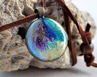 One of a Kind, Resin Necklace, Blue, Purple, Green Gold on a 14 inch adjustable suede cord