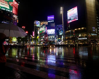 Shibuya crossing at night in the rain