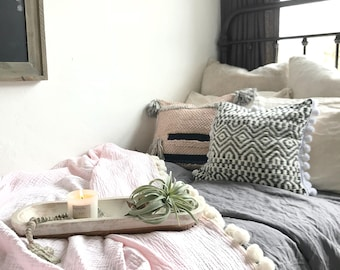 Pink Blanket with White Pom Poms