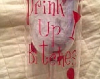 "A ""Drink up Bitches"" plastic wine glass tumbler"