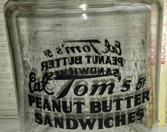"""Eat Tom's 5ct Peanut butter sandwiches Country Store Jar. Stands 13 1/2"""" and is 8 1/2"""" across. Great Cond. Nice Graphics. No fading."""