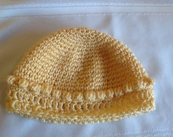 Crocheted baby hat with puff stitch detail, soft yellow