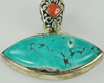 PRICE REDUCED - Turquoise Eye Pendant with Sterling Silver and Coral bail