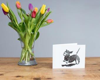 Dachshund and ball greetings card - white