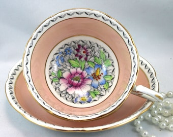 Royal Grafton Teacup & Saucer,Lovely Floral Pattern in the Center, Pastel Peach Borders, Gold Rims, Bone English China made in 1950s