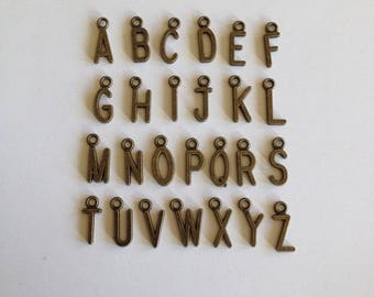 Metal Alphabet Charms. Antique Brass Alphabet Charms. Gold Alphabet Charms. Alphabet Charms. Gold Charms. Mini Alpha Charms. Metal Charms.