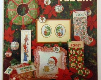 """Counted Cross Stitch patterns book """"A Christmas Album"""" Needleworks 1980 Santa Angels Stocking"""