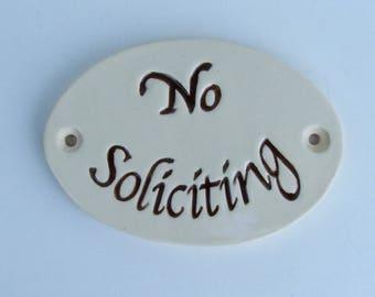 "Ceramic Door Plaque, ""No Soliciting"" Dark Brown"