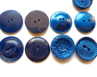 Different sets of 2 or 6 large vintage plastic blue 35 mm diameter, 2 hole buttons.