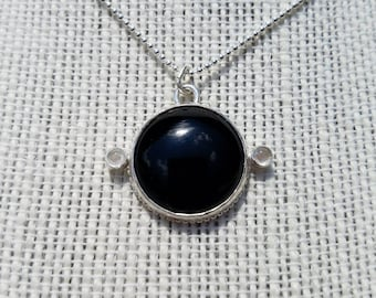 Sterling silver black onyx and moonstone pendant