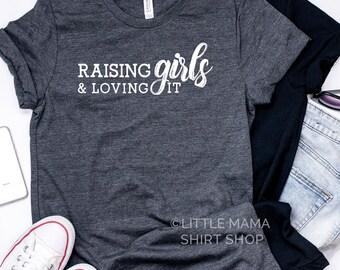 Raising Girls and Loving It ©   Girl Mom Shirt   Mom Graphic Tee   Mom Life Shirt   Trendy Tees   Girl Mama   Women's Shirt   Mom of Girls