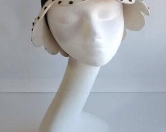 Cloche hat with scalloped brim