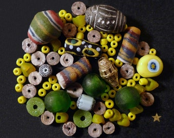 African glass beads, brass, wood and terracotta