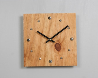 Plywood clock with stainless steel hour markers and Tung oil finish.  USPS priority shipping to USA ncluded