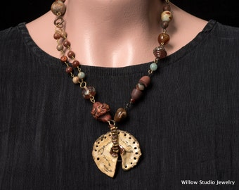 The Message, a rustic assemblage necklace of artisan beads, boho asymmetrical in style, and multicolored