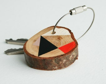 Pine wood keychain with stainless steel cable wire, black, white, pink and orange geometric triangle shapes keyring