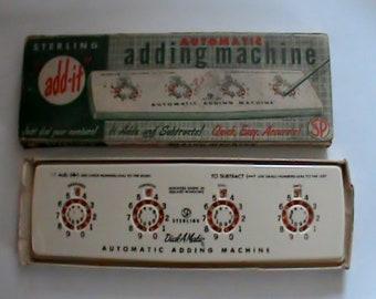 Neat novelty 1950s adding machine. Sterling Automatic in original box