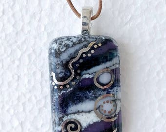 Glass pendant in navy and purple hues with silver accents