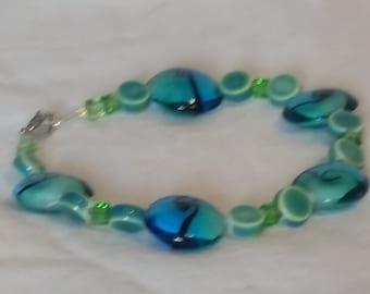 Blue glass beads with swirls bracelet