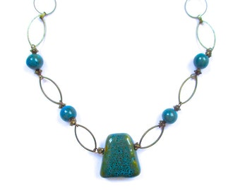 Turquoise Glazed Clay Bead and Antique Brass Link Chain Necklace With A Trapezoid Pendant