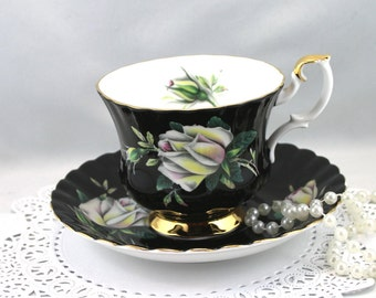Royal Albert Tea Cup & Saucer,White Large Rose on Black Background, Montrose Shape,Gold Rims, Bone English China made in 1970s
