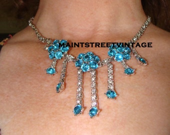 Ora Sparkling  Pave' 3 Blue and Crystal Flowers Dangle Rodium  Necklace