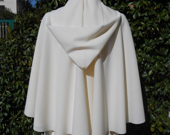 Spring  cape in warm and light crepe wool with large  hood