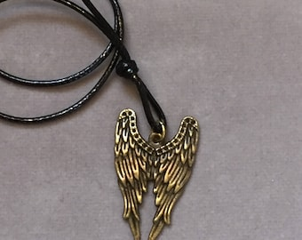 Faded gold wing spread pendant cord necklace