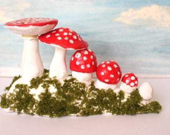 Big mushroom growing up clay sculpture