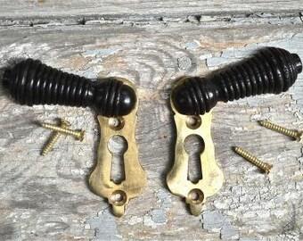 Pair of ebonised black wood and brass beehive door keyhole cover escutcheon key hole N2