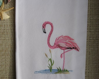 A Pink Flamingo. Embroidered on a white solid weave cotton towel.Pink Flamingo on white waffel weave towel.