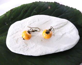 Earrings vintage orange ceramic beads, lustrous bronze hook.