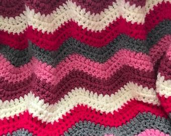 Chunky crochet ripple blanket in pinks