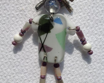 Bed Head Pin : Fused Glass White with Green, Purple, and Blue Detail T-shirt with Beaded Arms & Legs