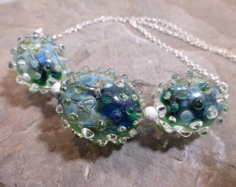 blue and green oval lampwork glass beaded necklace